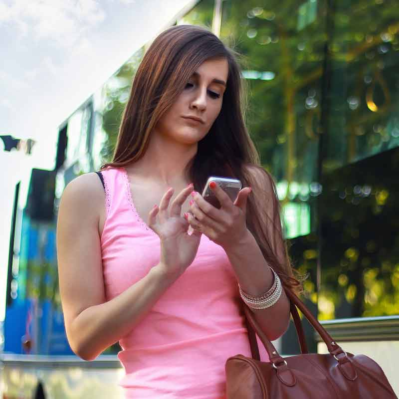 Photo of young woman on cell phone for Digital Wealth