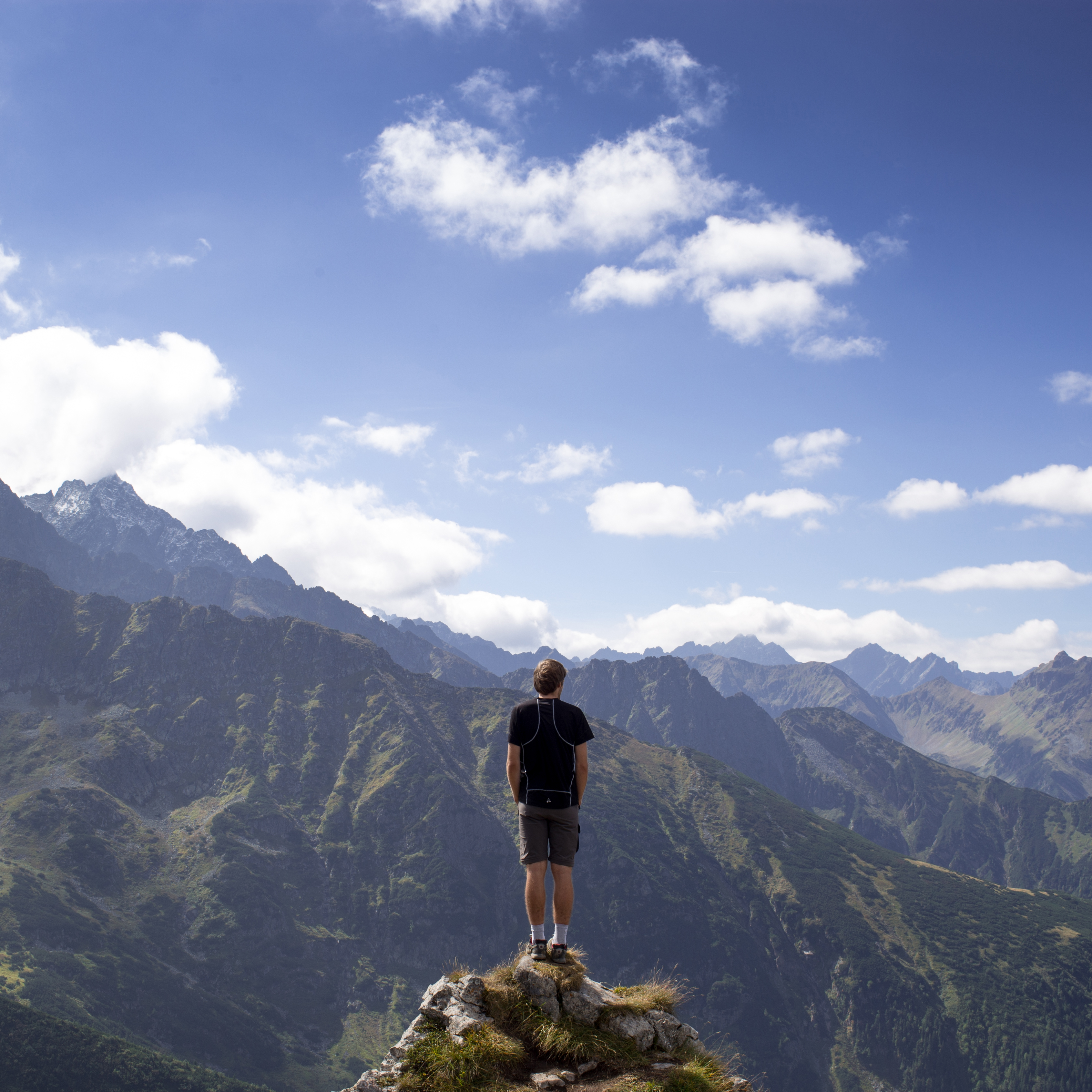 Photo of a tech professional on a mountain top looking at vista